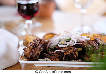 Kebab with glass of wine - Traditional delicious kebab with...
