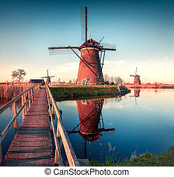 Colorful spring scene in the famoust Kinderdijk canals with...