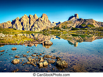 Colorful summer scene on Rienza lake in National Park Tre...