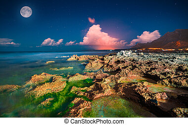 Night view of the nature reserve Monte Cofano. Full moon and...