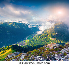 Campitello Di Fassa village in the morning mist - View from...