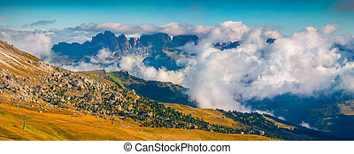 Foggy sunny panorama of the Val Gardena valley. View of the...