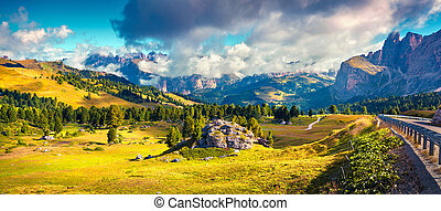 Sunny morning scene in the Val Gardena valley. Colorful...