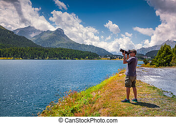 Photograpther take picture on the Silsersee lake. District...