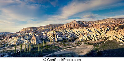 Colorful evening scene in Cappadocia. Red Rose valley in the...