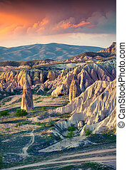 Unreal world of Cappadocia. Sunrise in Red Rose valley in...