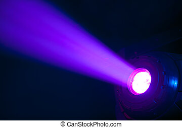 Stage spot with purple light beam - Stage spotlight with...