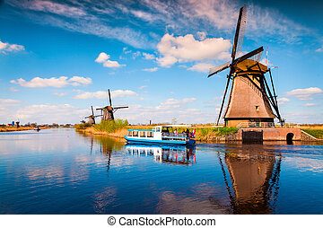 Walking boat on the famous Kinderdijk canal with windmills....
