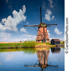 Sunny spring scene on the canal in Netherlands. Dutch...