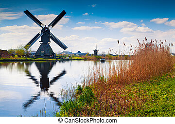 Sunny spring scene in the canal in Netherlands. Dutch...