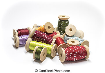 Heap of spools with ribbon - Ribbon on wooden spools