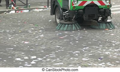 Vehicle is cleaning the road. Litter in the street. Brushes...