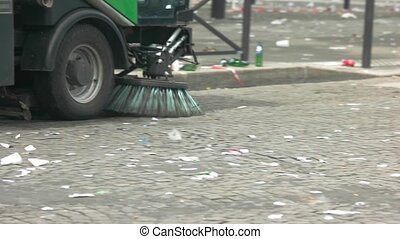 Car is cleaning the street. Trash on road. Make contribution...