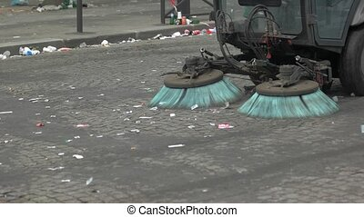 Car is cleaning the road. Garbage on the street. Reduce...