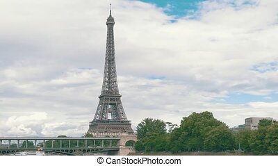 Eiffel tower from a distance. Transport on Bir Hakeim...