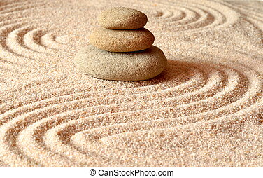 stones on the sand with circles