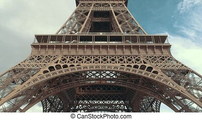 Eiffel tower from below. High structure on sky background....