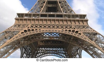 Clouds over Eiffel tower. High monument and sky. Memorable...