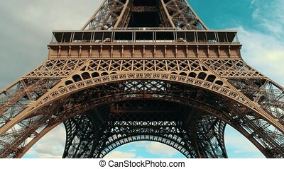 Eiffel tower at daytime. Tall monument and cloudy sky....