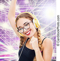 Music teenager girl dancing with headhpone in the discoteque