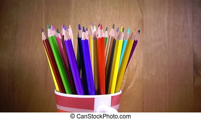 the mug with bright pencils turnsslow motion ,