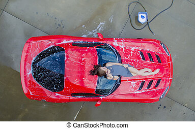 Brunette Model With Car - A brunette model washing a...