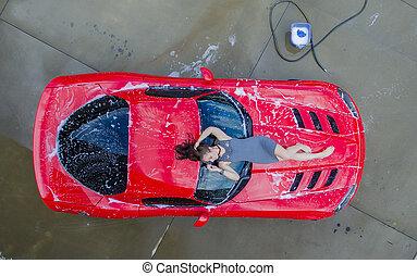 Brunette Model With Car - A brunette model washing a...