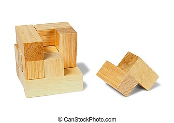 Wooden puzzle - Wooden logic puzzle on white background