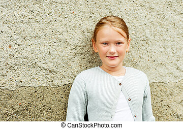 Close up portrait of a cute little girl of 8-9 years old,...
