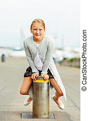 Outdoor portrait of a cute little 9-10 year old girl,...