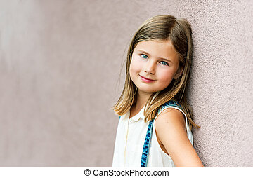 Close up portrait of a cute little girl of 7-8 years old...