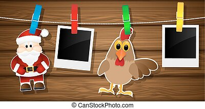 Blank photo frames, rooster and Santa Claus on a clothesline.