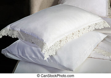bed linen and two pillows on the bed
