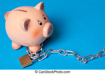 security your investment . piggy with chains and padlock