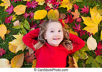 Little girl playing in autumn park - Happy little girl...
