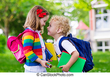 Kids on first school day - Child going to school. Boy and...