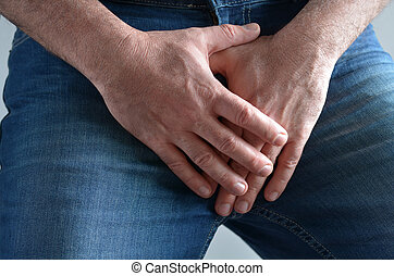 Man hands covering his painful crotch - Close up on a man...