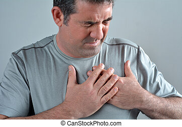 Man having acute pain in a his chest Close up of Middle age...