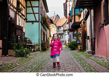 Little girl in historical city center in France - Cute...