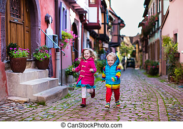 Children in historical city center in France - Cute little...