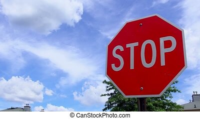 Stop sign with fast moving clouds stop sign clouds sky