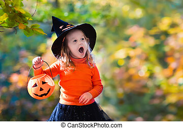 Little girl in witch costume on Halloween