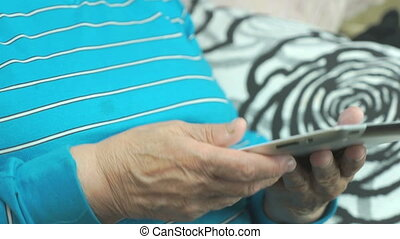 Elderly woman using a computer tablet