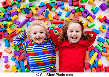 Children playing with colorful blocks. - Happy preschool age...
