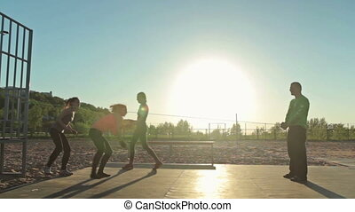 Group of people doing trauning exercise with rope, outdoor...
