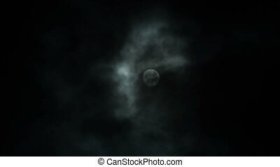 Night view at the moon through moving clouds
