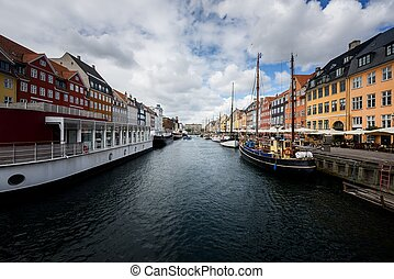Nyhavn pier with color buildings - Scenic spring view of...