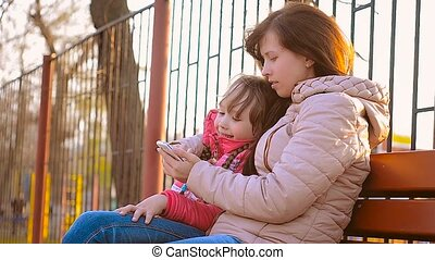 A woman and her daughter doing selfie