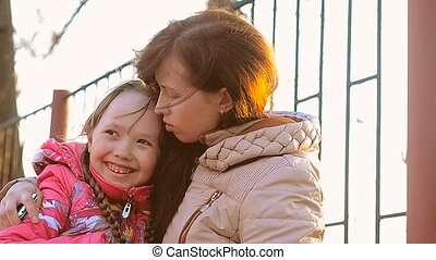 Woman with daughter hugging