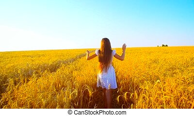 Girl runs with wheat across the field